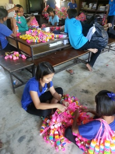 The day after the beauty pageant: students are assigned to detangle all of the flower garland thingy ma jigs.